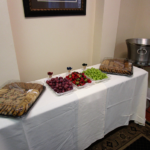 Fruit and cookie spread in an office for an event.
