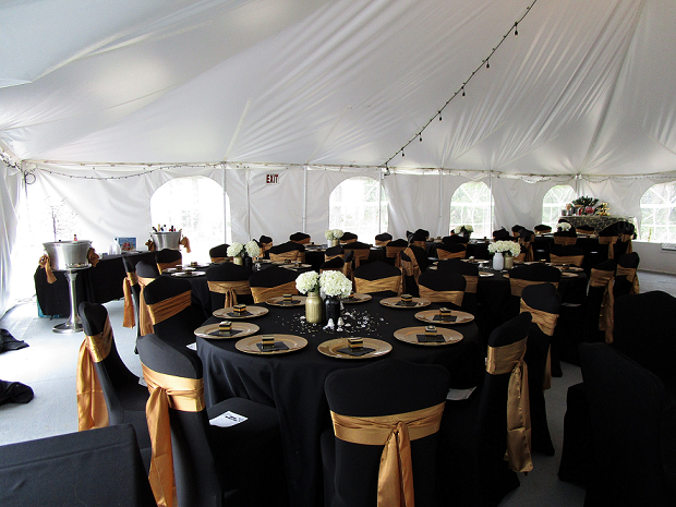 This was a birthday party that was held in our event tent.  The color scheme for it was black and gold.